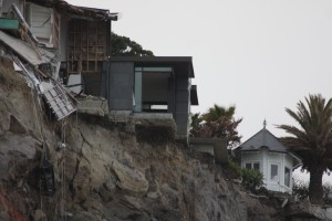 Dramatic view of earthquake damaged cliff top homes – Christchurch, New Zealand